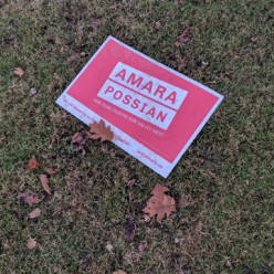 Walk with family - see one of Amara's lawn signs left over from the election's logo